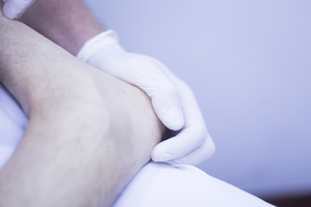 osteopath: Myofascial osteopathy physiotherapy treatment by physiotherapist and osteopath in physical therapy rehabilitation treatment on patient on leg, ankle and foot. Stock Photo