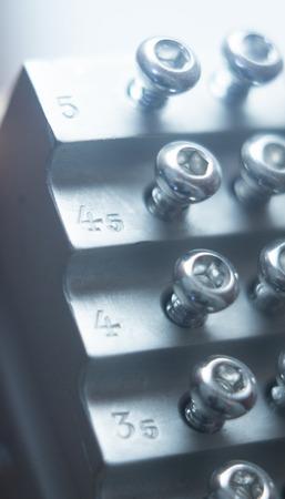 orthopaedics: Orthopedics and Traumatology surgery rack of screws to fix surgical titanium metal implants close-up isolated photo.