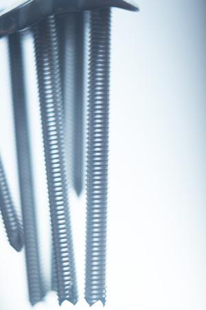 traumatology: Orthopedics and Traumatology surgery plate & screws surgical titanium metal implant close-up isolated. Stock Photo