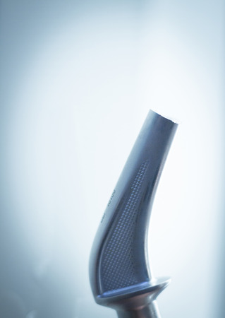 titanium: Orthopedics and Traumatology surgery hip replacement surgical titanium metal implant close-up isolated.