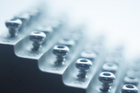 Orthopedics and Traumatology surgery rack of screws to fix surgical titanium metal implants close-up isolated photo.
