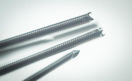 titanium: Orthopedics and Traumatology surgery plate & screws surgical titanium metal implant close-up isolated. Stock Photo