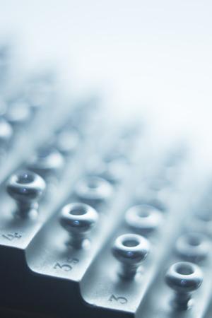 implants: Orthopedics and Traumatology surgery rack of screws to fix surgical titanium metal implants close-up isolated photo.