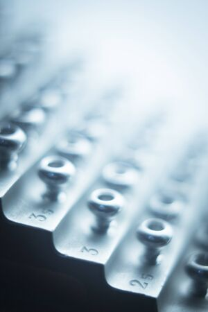 titanium: Orthopedics and Traumatology surgery rack of screws to fix surgical titanium metal implants close-up isolated photo.
