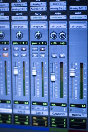 Professional sound recording audio studio digital equipment, amplifier, knobs and digital graphic equalizer controls on screen.