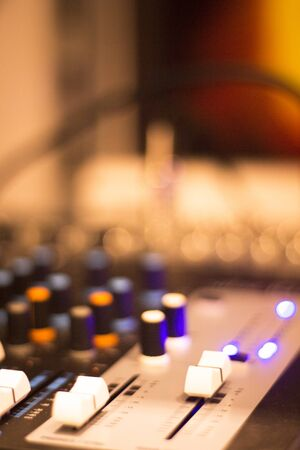 controls: Professional sound recording audio studio digital equipment, amplifier, knobs and graphic equalizer controls. Stock Photo