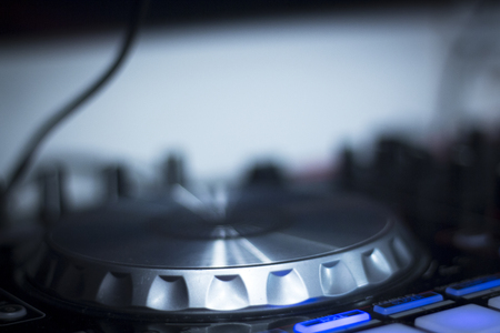 deejay: Ibiza dj turntables for deejay mixing in nightclub house music party at night during techno show.