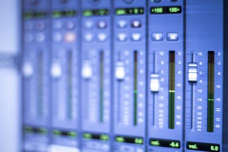 graphic equalizer: Professional sound recording audio studio digital equipment, amplifier, knobs and digital graphic equalizer controls on screen.