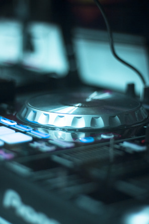 discoteque: Ibiza dj turntables for deejay mixing in nightclub house music party at night during techno show.
