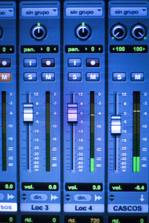 controls: Professional sound recording audio studio digital equipment, amplifier, knobs and digital graphic equalizer controls on screen.
