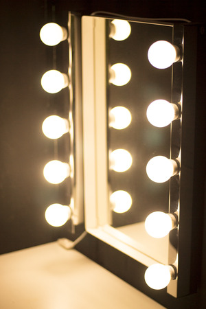 Studio makeup table mirror lights for professional make-up artists in photographic studio or theater.