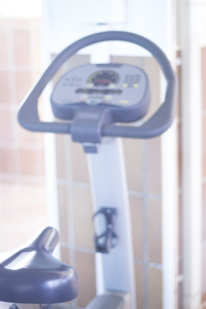 static: Gym bike exercise cycle machine for static indoor cycling in fitness and aerobic studio. Stock Photo