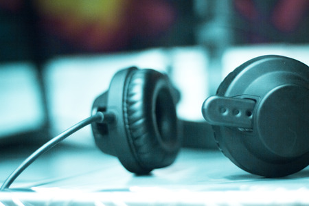 dubbing: Professional sound recording audio studio closed headphones to monitor recording music, musical instruments, voices, singing, dubbing and voiceovers. Stock Photo