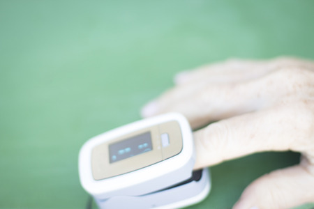 hand held: Portable hand held domestic cardiac finger pulse rate meter to show resting heart rate in monitored patient.