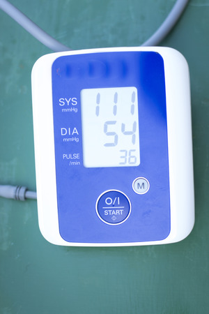 monitored: Cardiac blood pressure and irregular heart beat pulse rate meter to show resting heart rate in monitored patient. Stock Photo