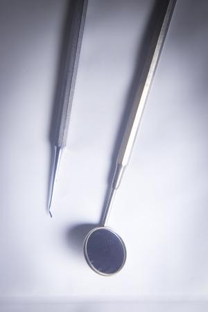 Instrumentation: Dentists dental instrumentation mirror.