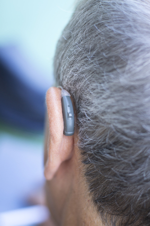 Modern digital hearing aid device for deaf and hard of hearing patients. Stock Photo