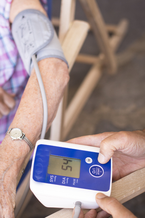 systole: Cardiac blood pressure and irregular heart beat pulse rate meter to show resting heart rate in monitored old aged female patient.