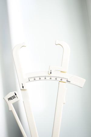 regimes: Bodyfat fat calipers used to measure percentage fat in different zones of the body for weight loss, fitness and bodybuilding regimes.