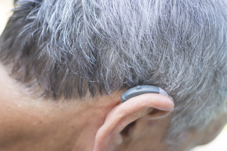 Modern digital hearing aid device for deaf and hard of hearing patients. Banco de Imagens