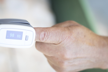 resting heart rate: Portable hand held domestic cardiac finger pulse rate meter to show resting heart rate in monitored patient.