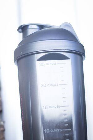 muscle gain: Protein shake shaker used to mix whey powder, glutamine, creatine and bcaas for post training in bodybuilding and fitness gym routines. Stock Photo