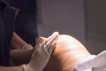 surgical operation: Anaesthetist pressing after anaesthetics injection before for surgical operation knee arthroscopy micro surgery in hospital.
