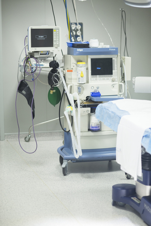 sterilized: Hospital surgery bed in operating theater emergency room prepared for surgeon to operate.