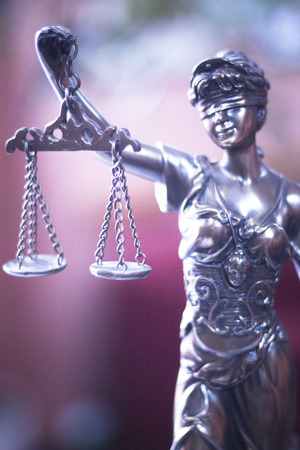 Legal office of lawyers and attorneys  legal bronze model statue of Themis goddess of justice.