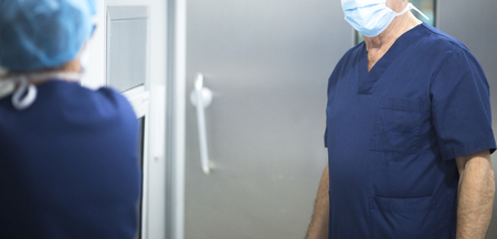 sterile: Surgeon in operating theater emergency room surgery in hospital clinic in blue surgical sterile uniform for operation.