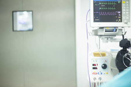 Electrocardiogram in hospital surgery operating theater emergency room showing patient heart rate.