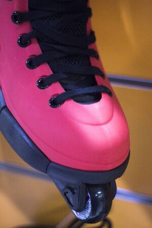 rollerskates: Aggressive inline free skates inline rollerskates for skating, jumps, tricks and urban skating in retail store shop display. Stock Photo