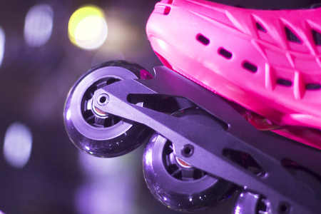 rollerskates: Freestyle pink ladies inline skates boots and wheels in retail store shop window for free, urban, slalom, fitness skating.