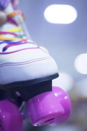 rollerskates: Childrens quad skate rollerskates in skate store in shop window display. Skates with four wheels and front brake for roller disco.
