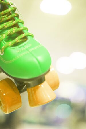 Childrens quad skate rollerskates in skate store in shop window display. Skates with four wheels and front brake for roller disco.