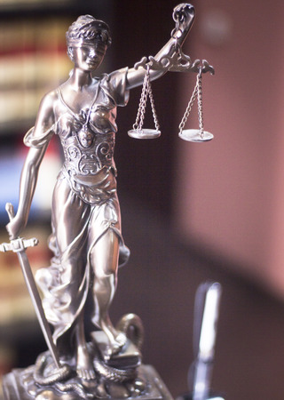 judicature: Legal office of lawyers and attorneys  legal bronze model statue of Themis goddess of justice.