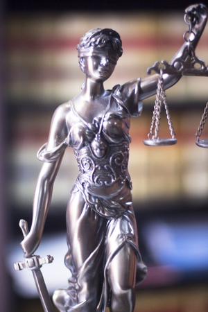 punishing: Legal office of lawyers and attorneys  legal bronze model statue of Themis goddess of justice.
