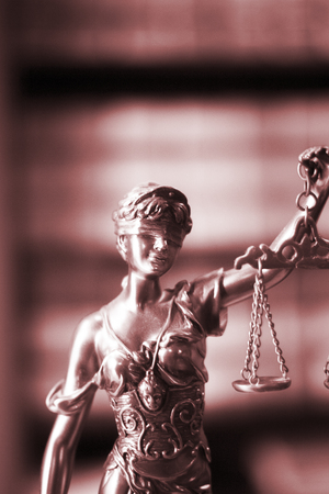 law report: Legal office of lawyers and attorneys  legal bronze model statue of Themis goddess of justice.