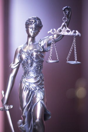 solicitors: Legal office of lawyers and attorneys  legal bronze model statue of Themis goddess of justice.
