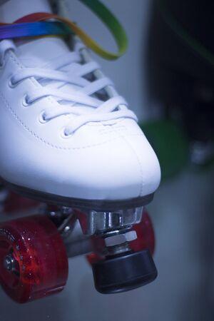 figure skate: Quad figure skate rollerskates in skate store in shop window display. Skates with four wheels for figure skating roller disco and jam skating.