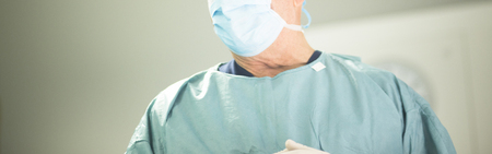 surgical scrubs: Surgeon in hospital surgery in sterile uniform scrubs and mask in operating theater emergency room in surgical operation.
