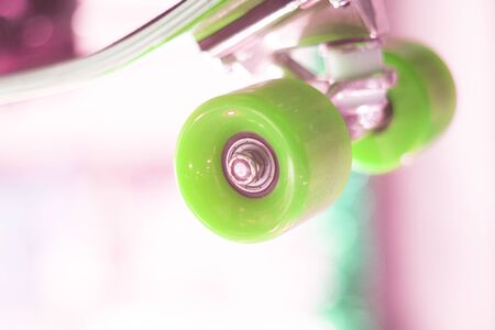 Skate board and wheels, axle and bearings in skates store on display in shop window on sale new and shiny. Stock Photo