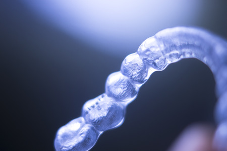 aligning: Invisible plastic modern technology dental tooth brackets aligners to correct teeth alignment in aesthetic dentistry.