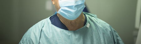 surgical scrubs: Surgeon in hospital surgery in sterile uniform scrubs in operating theater emergency room in surgical operation.
