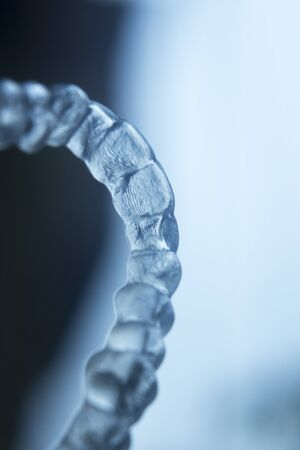 Invisible plastic modern technology dental tooth brackets aligners to correct teeth alignment in aesthetic dentistry.