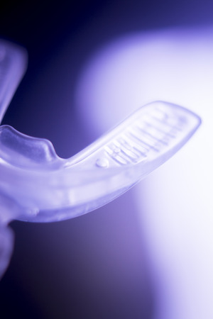Dental braces aligners accelerator for both modern invisible and metal brackets to straighten and align teeth. Stock Photo