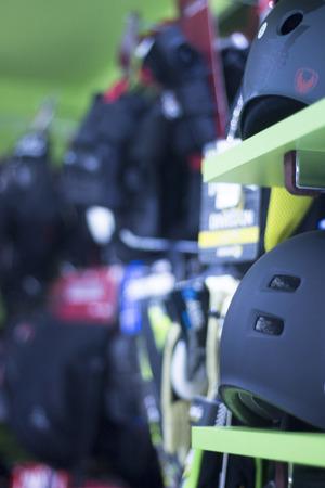 roller blade: Inline and quad roller skates helmet head protection in retail skate shop display on sale.