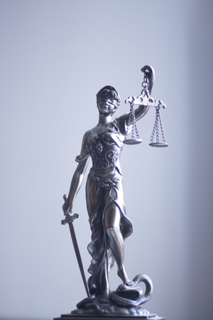 barrister: Law offices of lawyers legal statue Greek blind goddess Themis bronze metal statuette figurine with scales of justice. Stock Photo