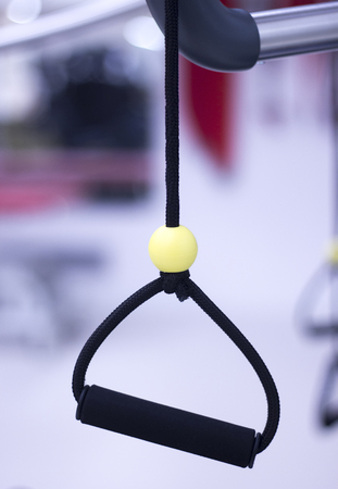 Suspension training physical therapy exercise equipment with cord gravity bodyweight resistance workout.