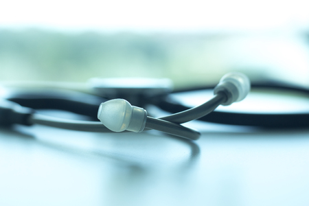 Doctors medical stethoscope heart rate monitoring equipment to listen to heartbeats of patient,